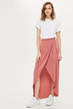 Channel a model-off-duty look with this maxi skirt in trending a rose hue. In a wrap design with a tie at the waist, it's perfect for teaming with a plain tee and trainers.