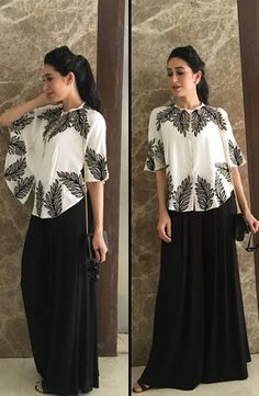 The actor picked easy-breezy separates by Malini Ramani that she paired with a Ferragamo sling and a voluminous ponytail.