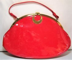 Vintage tomato red vinyl patent leather purse Great mod design, with a gold tone frame Lined in black fabric Label reads L and M, Bags by Edwards, Made in USA Minor light pitting on frame, does not detract, a few light scratches on the back, does not detract Body of bag is 10 x 15 inches, 5 inch strap drop Good vintage condition International buyers welcome, and overcharges refunded Priority option is offered 41917  Credit cards and Paypal accepted