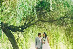 Bride & Groom wedding portrait, under willow tree. Peasholm Park, Scarborough, North Yorkshire.
