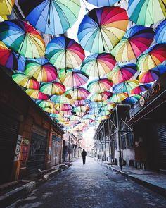 Rainbow umbrella covered street in Karaköy, İstanbul by Martina Bisaz. (via Instagram - kitkat_ch) #turkey #türkiye #istanbul #karaköy #umbrella #street #umbrellastreet #şemsiyelisokak #şemsiye sokak