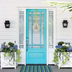 i am obsessed with front doors.  i love them.  and i'm madly in love with this one!!