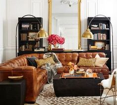 Ken Fulk quilted leather sectional; couch / sofa; living room; lamp / lighting; bookshelf | Image source:Pottery Barn
