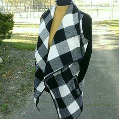 """Black and White Plaid Sweater Coat Gorgeous sweater coat in a wool/poly blend with ribbed sleeves. Faux leather trim detail on front, back and pockets  (pix 4). Generous folding lapels and a 51"""" leather tie belt. Great styling possibilities!  Brand New!   Measurements: 4"""" neck cuff, back length 26 """"/front 33"""", sleeve 24 1/2"""", bust 40"""".  Fits: 10 possibly 12.  NO Trade / NO Paypal Jackets & Coats"""