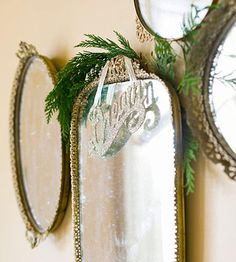 It appears that they used vintage ladies' mirrored dressing table trays to decorate the wall....then spruced them up for the holidays with a little greenery and ornament!