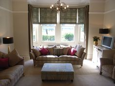 roman blinds and dress curtains