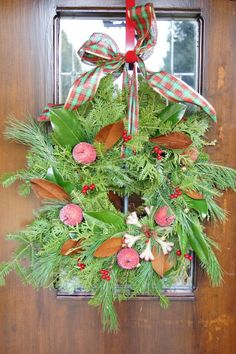 Supplies for wreath making - Find glitzy items and ornaments to decorate a plain evergreen wreath form. Use a large ribbon tied in a bow to hang