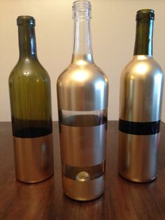 fabulous metallic wine bottles // great centerpiece idea!