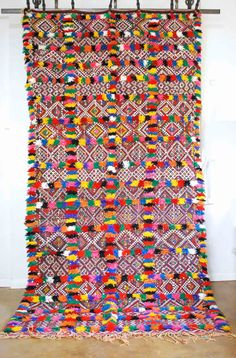 This gorgeous pom pom carpet is one of the best things I have ever had in my shop.  Now for sale!  #Moroccandesign