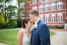 Jule Collins Smith Museum Wedding Photos with the classic kiss on the forehead as the bride beams with joy. | Auburn, AL