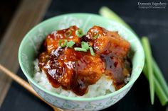 General Tso's Tofu Recipe Main Dishes with extra firm tofu, corn starch, canola oil, brown sugar, hoisin sauce, rice vinegar, ketchup, soy sauce, water, red pepper flakes, sesame oil, green onions, fresh ginger