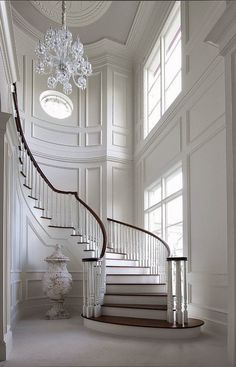 Unbelievable white entry foyer and curved staircase, fabulous trim. Maybe change the floor color n the wall for my entry n stairs Curved Staircase, Grand Staircase, Staircase Design, Staircase Ideas, White Staircase, Staircase Molding, Spiral Staircases, Modern Staircase, House Staircase