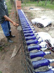Changing the world one bottle at at time. - Home Bottle Brick. Changing the world one bottle at at time. Plastic Bottle House, Earthship Home, Recycled House, Glass Building, Recycled Glass Bottles, Bottle Wall, Garden Fencing, Outdoor Projects, Diy Projects
