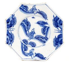 ¤ English Delftware Octagonal Plate, circa 1670-90 Of unusually moulded form and painted in blue with Chinese figures in a highly stylised landscape, 20.3cm diameter Provenance: The S J McManus Collection.