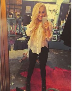 Love the look RaeLynn! You can get it too: White Pirate shirt – Free People, Black pants – Urban Outfitters