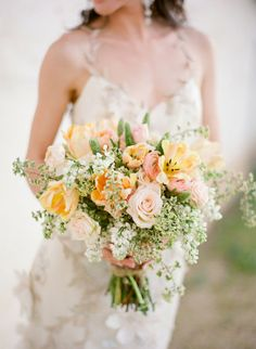 yellow and peach bouquet. natural  For more great ideas visit our website, www.tidewaterwedding.com or call 443 786 7220