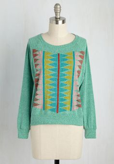 As you sing along to your favorite record in this heather green pullover by Supermaggie, you admire how it perfectly personifies the tunes. Miming the music with triangular waves of red, pink, goldenrod, and blue, this raglan-sleeved top inspires a stylish melody of it's own.