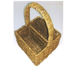2 section seagrass square basket static handle, exclusive to Choice Baskets. The seagrass is woven in a horizontal direction around a strong metal frame, and the two sections are ideal for cutlery, napkins, sauces/oils or even for make up and pens. This basket has a strong static handle made of metal with the seagrass woven around it. Could also be used for storing remote controls or mobiles. Wanting a different gift, for a child fill the basket will colouring pens and pencils or paint…