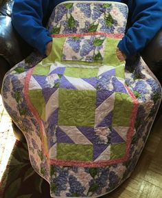 Lilac Lovie Lap Quilt with pockets, great gift for Mom or Grandma.  Purchase at http://www.homesewnbycarolyn.com