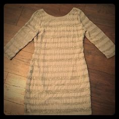 Romeo & Juliet Couture Beaded Dress Romeo and Juliet Couture taupe beaded dress. Fully lined with sheer sleeves. Alternating rows of criss cross patterned clear beading. 100% polyester. A few spots where beading has fallen off but in great condition. Romeo & Juliet Couture Dresses Wedding