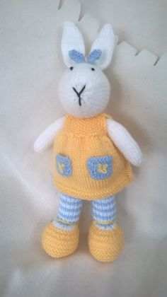 Welcome to DreamDollies.  This little girl bunny is dreaming of hopping off to her new home.  She is hand knitted in acrylic wool and stuffed with 100% hypo-allergenic toy stuffing.  She is approximately 12 inches/30 centimetres tall from the tip of her ears to her toes. Clothing is not removable.  Many thanks for looking.