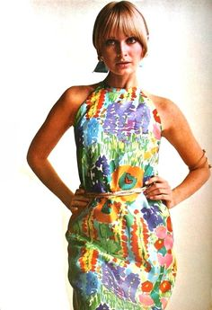 Sue Murray in a silk halter dress splashed with expressionist flowers, 1969