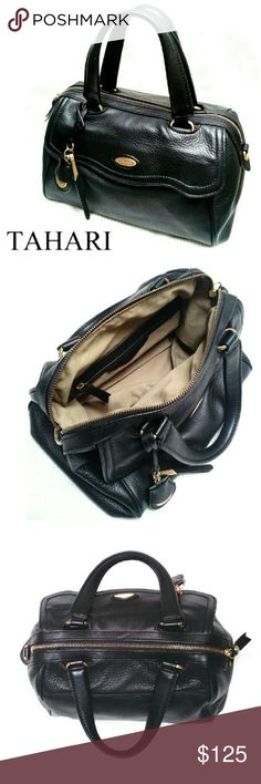 """TAHARI SOFT BLACK PEBBLED LEATHER SATCHEL TAHARI SOFT BLACK PEBBLED LEATHER SATCHEL Pre-Loved  / EUC GORGEOUS!  *   Soft Black Pebbled Leather *   Gold Hardware *   Front Scalloped Compartment w/Magnetic. Closing *   2 Handles *    Zippered Opening *   1 Zip Compartment w/2 Slip Pkts. Approx. Meas;    *   H   9""""    *   L   12""""    *   W   5 1/2""""    *   Drop   5"""" Pls See All Pics. Ask ? If Needed Tahari Bags Satchels"""