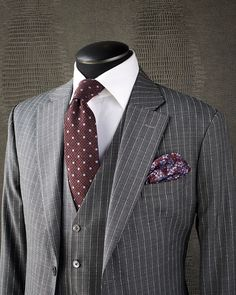 CLASSIC STRIPE The perfect summer version of your classic business suit. This KING & BAY Light Weight Stone Grey Striped Suit features a…