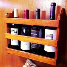 This magazine holder was mounted to our bulkhead and wasn't being used until voila! I realized it was perfect for doubling as a wine rack! Or liquor bottles. Sailboat Living, Living On A Boat, Boat Storage, Wine Storage, Liveaboard Boats, Liveaboard Sailboat, Boat Organization, Boating Tips, Sailboat Interior