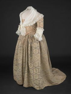 "Gown: 1780's, painted silk taffeta. Worn by Martha Washington.    Housed in the ""First Ladies at the Smithsonian"" Gallery (expanded and re-opened 11/19/2011) of the National Museum of American History."