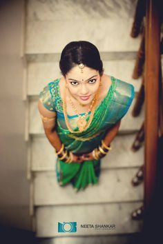 Traditional Southern Indian bride wearing bridal silk saree, jewellery and hairstyle. #IndianBridalMakeup #IndianBridalFashion. Temple jewelry. Jhumkis. Silk kanchipuram sari. Braid with fresh flowers. Tamil bride. Telugu bride. Kannada bride. Hindu bride. Malayalee bride
