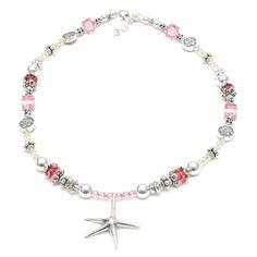This choker has that carefree feeling synonymous with Florida! Vibrant bursts of color from yellow, pink and coral Swarovski crystals combine with Sterling Silver beads to create a colorful choker. A stunning Sterling Silver starfish pendant is the perfect focal point of this piece.$286 #Floridajewelry #Palmtreejewelry #Naplesbracelets #Flamingobracelets