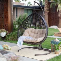 Grab a blanket and a book and snuggle into theBelham Living Samos Resin Wicker Hanging Double Egg Chair with Cushion and Stand. This chic mod hanging loveseat adds fun style to your sunroom, deck, or patio. Wicker Swing, Egg Swing Chair, Hanging Egg Chair, Hammock Chair, Swinging Chair, Garden Chairs, Patio Chairs, Outdoor Chairs, Adirondack Chairs