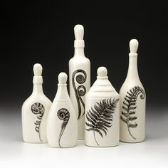 Botanical Jars by Laura Zindel - She has many products done in this style including table ware, other ceramics, and textiles, black on white only.  Everything is so simple and beautiful, and the prices are reasonable for handmade artworks.