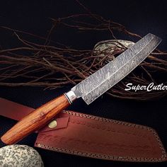Custom Handmade Damascus Chef Knife with Rose Wood Handle Blade length : 7.5 inches Handle length : 5 inches Steel: Damascus Pattern : Twist Hardness: 55 to 60 Layer: 215 Sheath: Genuine cow leather Remarks: As a result want you to enjoy your purchase of your new knife and to always be careful and use caution with all knives. Therefore, never misuse your knife. With proper care and usage, your knife will last for generations. We would like to take this opportunity and Thank You for you...
