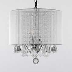 This beautiful Chandelier is trimmed with Empress Crystal(TM)100% Crystal Chandelier. A Great European Tradition. Nothing is quite as elegant as the fine crystal chandeliers that gave sparkle to brilliant evenings at palaces and manor houses across Europe. This beautiful chandelier has 3 lights and is decorated and draped with 100% crystal that capture and reflect the light of the candle bulbs. This wonderful chandelier also comes with the large shade as shown. The timeless elegance of this…