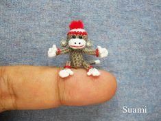 lovely Sock Monkey Pom Pom Hat Tiny Crocheted Gray Sock door SuAmi
