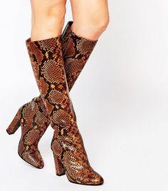ALDO snake print knee high boots.