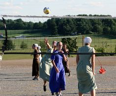 Amish Volleyball Tournament    Girls playing volleyball at a volleyball tournament at the Mt. Hope Auction grounds. Mt. Hope is a very large Amish center found in Holmes County Ohio. Suprisingly volleyball is huge among Amish children and teenagers. These teenagers even had kneepads and tennis shoes on!