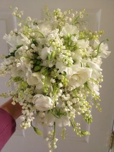 Bridal bouquet with more than 100 stems of Lily of the Valley, also sweet pea and white lilac - - -by Holly Heider Chapple