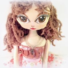 Her name is Monica and she has a cute girlish look. She is clever, calm and wears an owl jewellery which symbolise her sense for the knowledge.