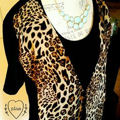 PLUS Leopard Top So cute and flattering on. It's basically a long black tee with a cheetah print vest attached to the front. Wear prints with class :) NWOT! Tops Blouses