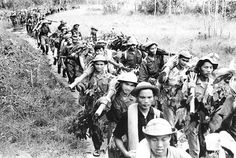 Marching down the Ho Chi Minh trail towards South Vietnam.