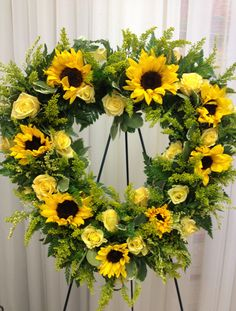 Sunflowers and other yellow flowers in a heart shape