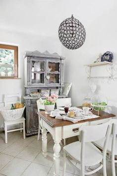 Provencal-style kitchen - the kitchen table is a family keepsake.  Agnieszka dresser bought at the antique shop in Kazimierz.  Cleaned it and lightly pobieliła.  Provencal style, white furniture, kitchen, white, chair, table, dining room, interior, cupboard, wooden furniture