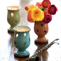 """Ideal for casting soft light onto your table or mantel, these luminaries are also great on a buffet holding spoons or skewers. Food safe, but not for use in oven or microwave. Add glass votive for use with flowers. Set of three: one of each color. (3"""" diameter x 5"""" tall)"""