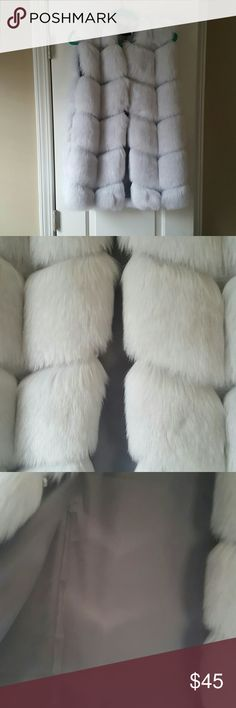 Gray faux fur vest Gray faux fur vest with pockets and hooks for closure. Sits about waist length depending on height. Faux fur is soft and beautiful! Size is XL but is in Asian size. Fits more like an American medium. Jackets & Coats Vests