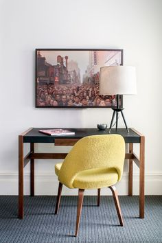 Iconic midcentury modern pieces — a Jens Risom desk and Saarinen Executive Chair