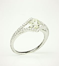Victorian raw diamond engagement ring that features a beautiful untouched clear/light yellow rough.