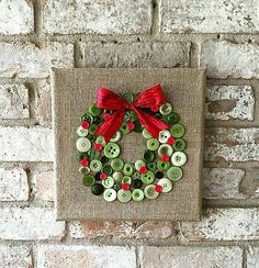 button wreath on square canvas with burlap cover